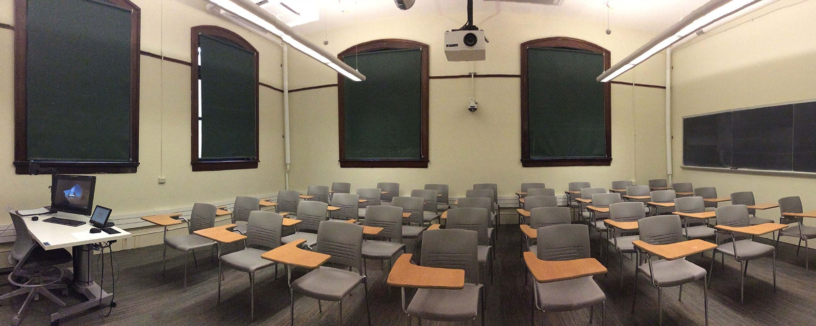 Carnegie 114 Panorama from front to back, chairs moveable with desk attached, teaching station to left of entrance