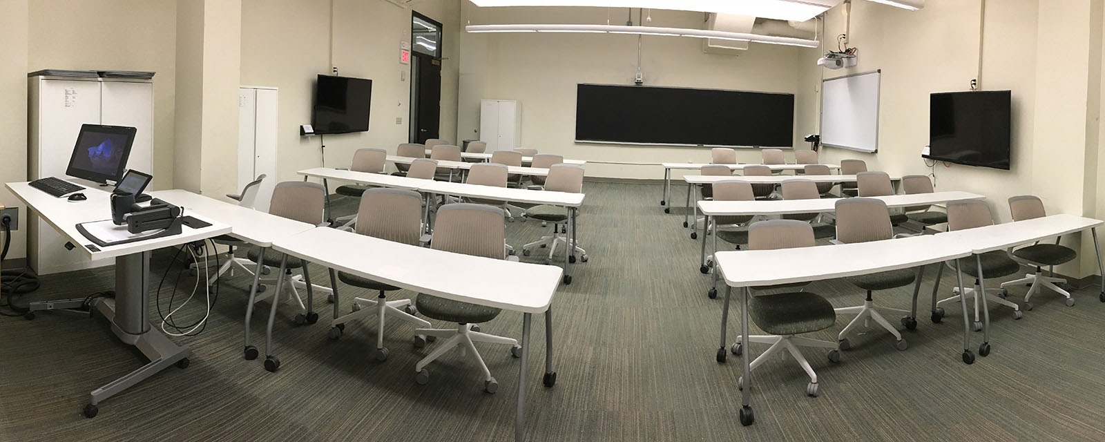Panorama of Carnegie 120 from front to rear, chairs moveable with tables, teaching station straight across from entrance