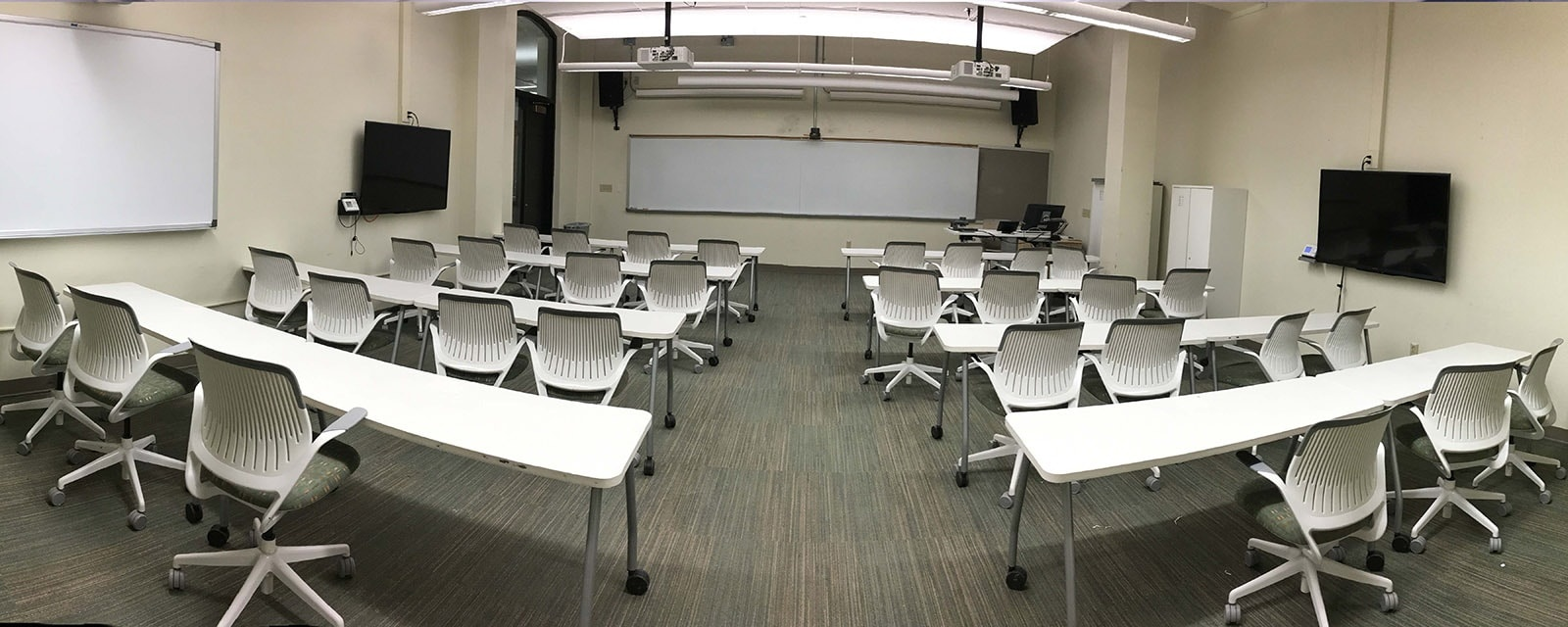 panorama of carnegie 120 from rear to front, chairs moveable with tables, teaching station straight across from entrance