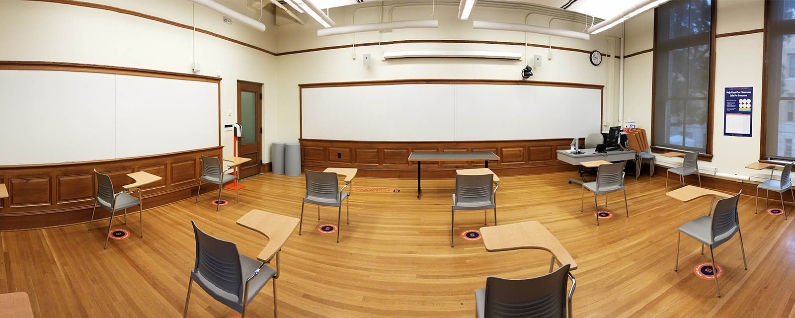 Panorama of Carnegie 219 from rear to front, chairs moveable with desk attached, teaching station straight across from entrance
