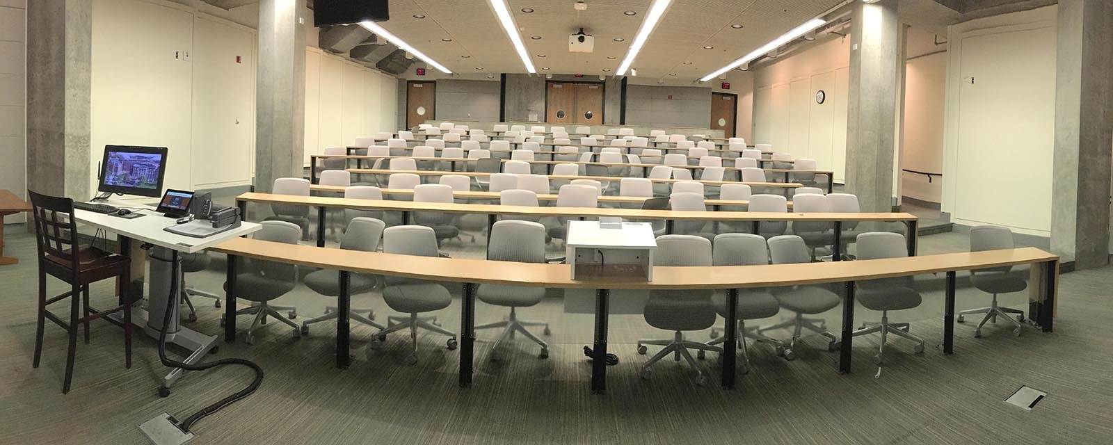 Panorama of Eggers 010 from front of room, chairs moveable with stationary desk, teaching station at left front of room