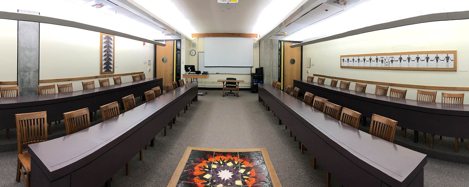 Panorama of Eggers 018 from rear of room, chairs moveable on stationary desks, teaching station front right