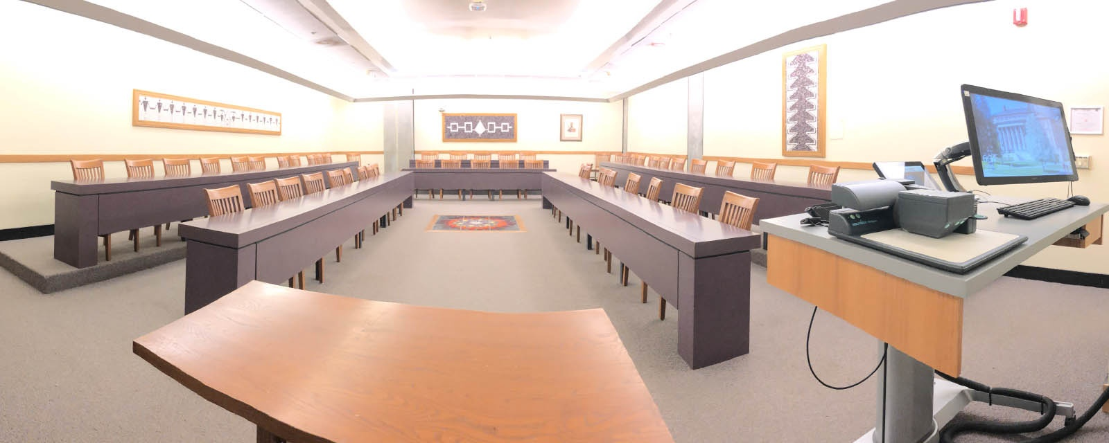 Panorama of Eggers 018 from front of room, chairs moveable on stationary desks, teaching station front right