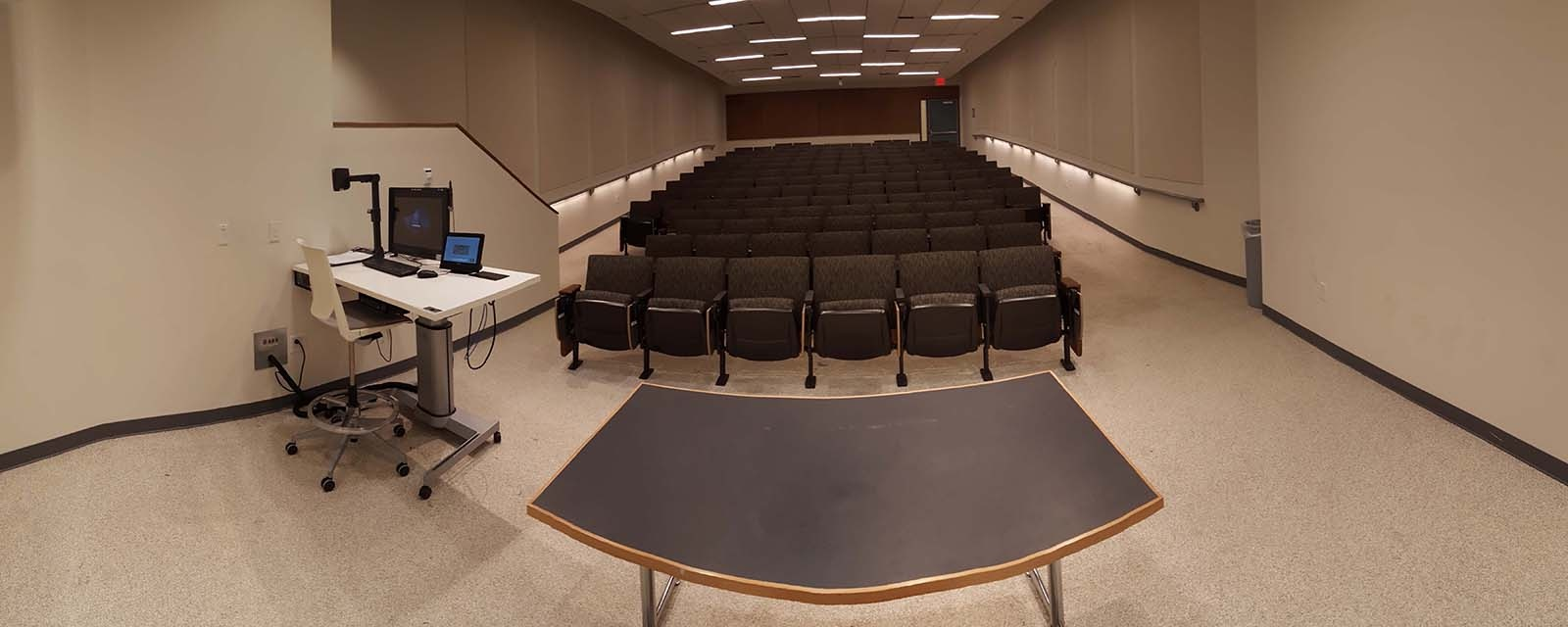 Panorama HBC Kittridge Auditorium from front of room to back of room, stadium seating, teaching station front left