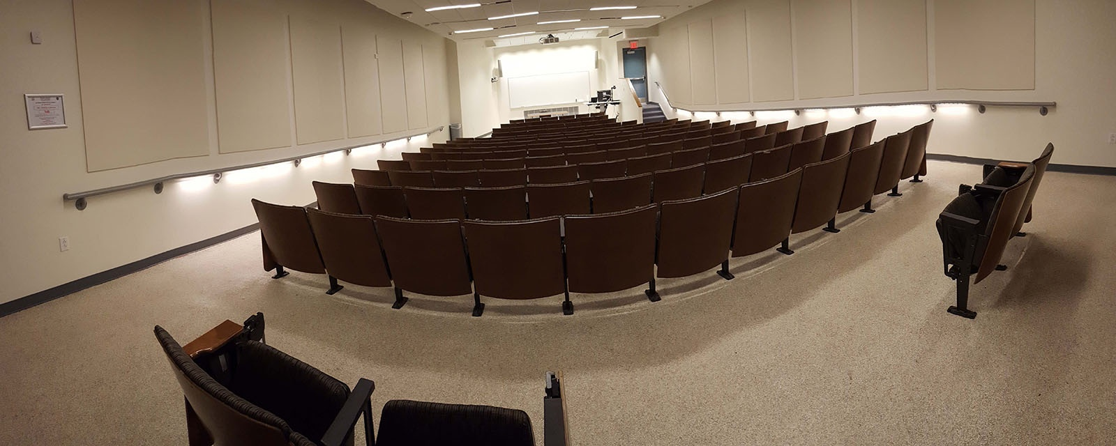 Panorama HBC Kittridge Auditorium from back of room to front of room, stadium seating, teaching station front left
