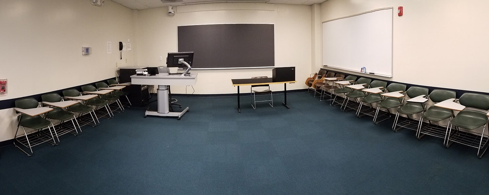 Panorama MSQ room 202A from back of room to front of room, movable chairs, teaching station front right