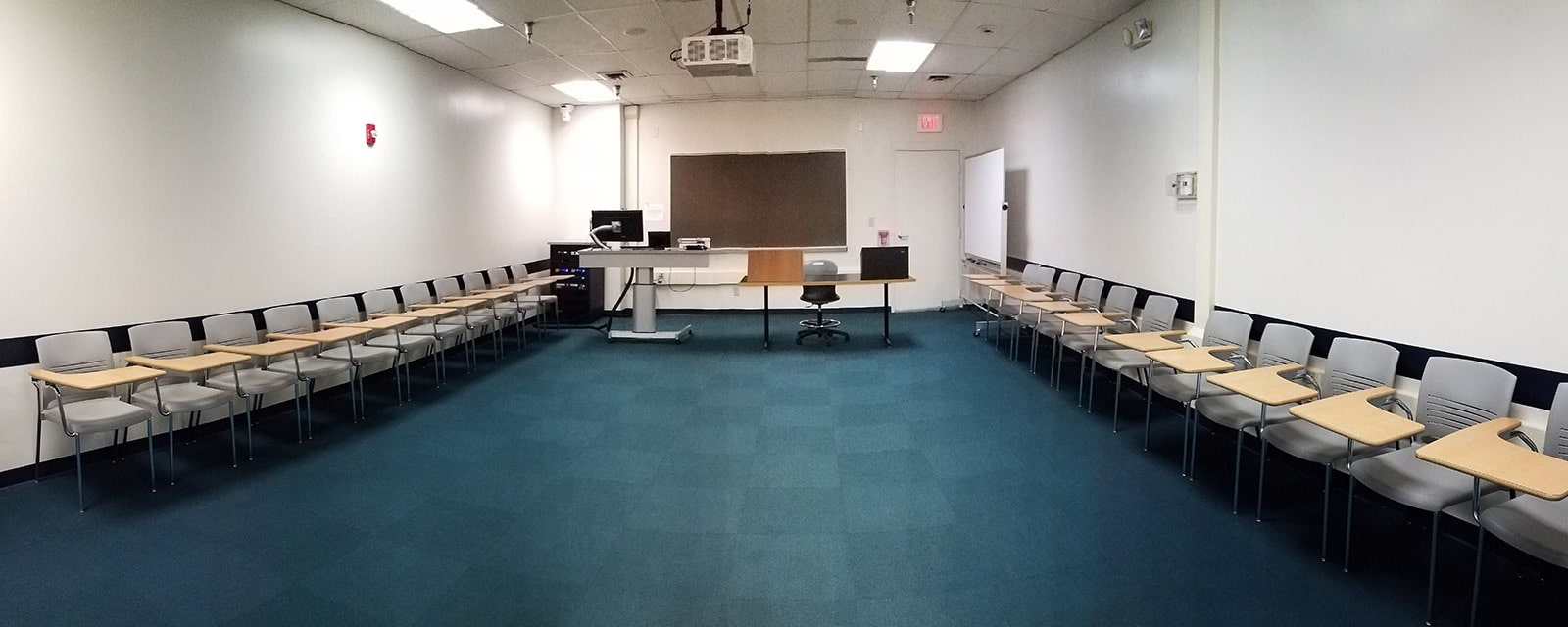 Panorama MSQ room 2028B from back of room to front of room, movable chairs, teaching station front right