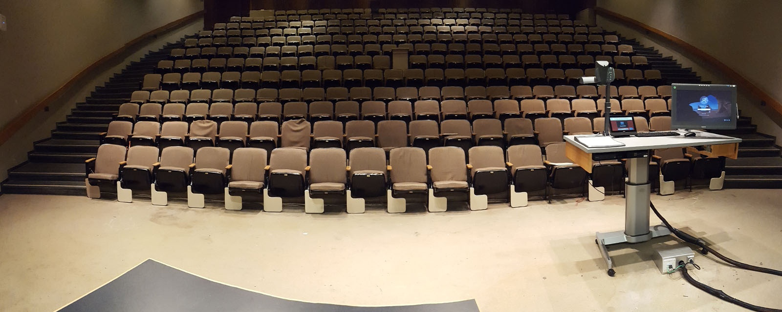 Panorama of Stolkin from rear of room, stadium chairs, teaching station front right