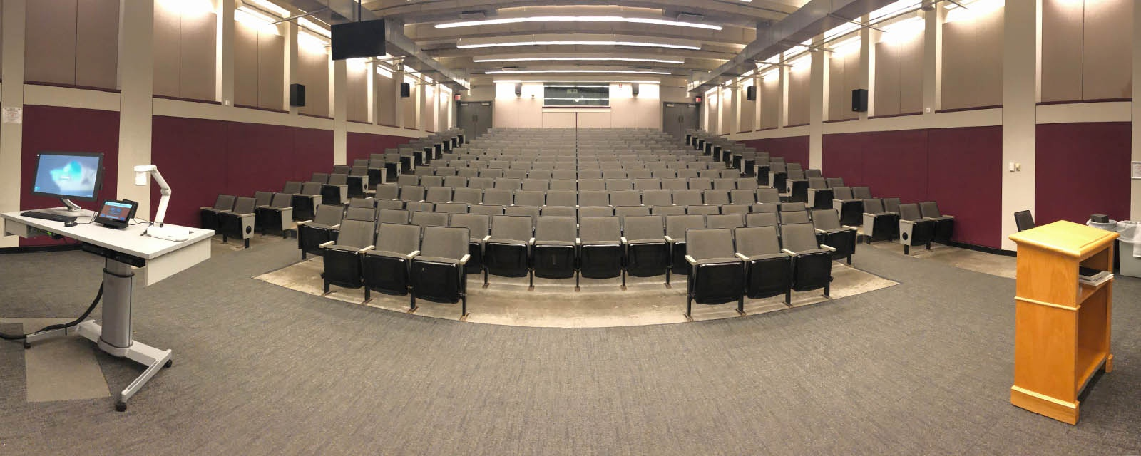 Panorama Shaffer Shemin Auditorium from front of room to back of room, stadium seating, teaching station front left