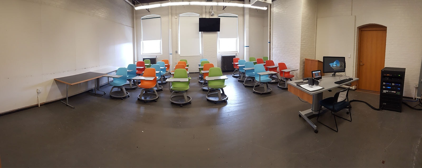 Panorama of Smith 337 from front of room, movable chairs, teaching station front right
