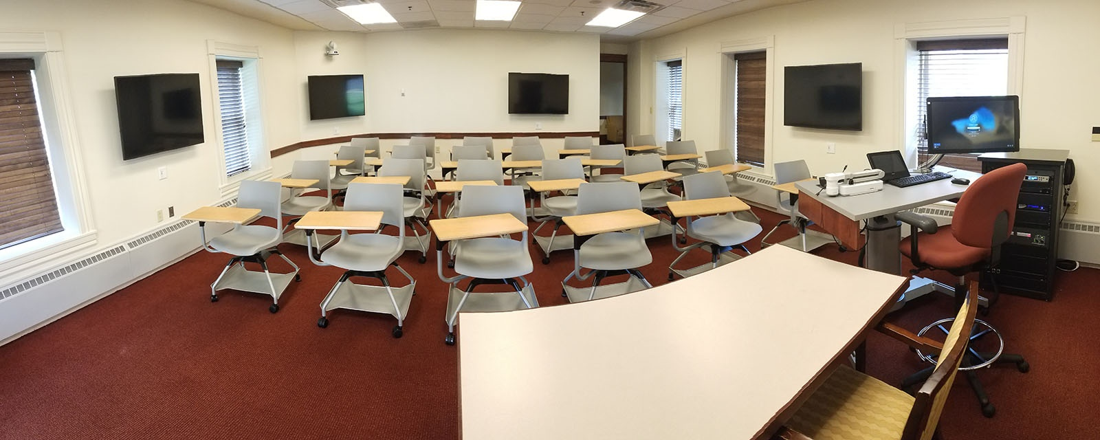 Panorama of Tolley 104 from front of room, movable chairs, teaching station front right