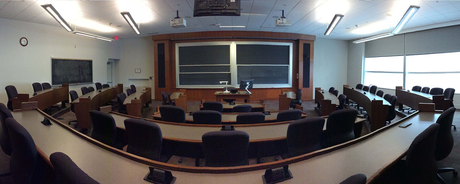Panorama of SOM 101 from rear of room, stadium seating, moveable chairs, teaching station in front center