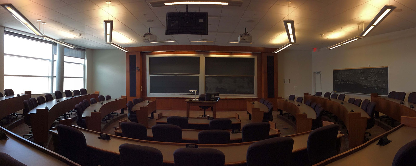 Panorama SOM 303 from back of room, stadium seating, movable chairs, teaching station in front left