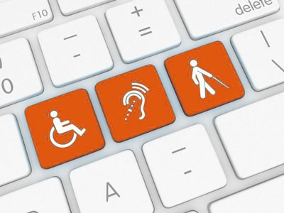 keyboard with accessibility symbols on 3 keys in orange
