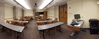 Panorama of Eggers 070 from front of room, chairs moveable at tables, teaching station front right