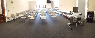 Panorama of Slocum 101 Front, movable chairs, teaching station front right