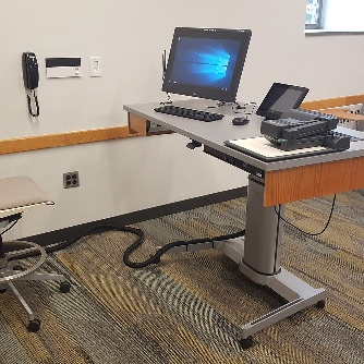 Panorama of HL 105 front, movable chairs with desk attached, teaching station front left